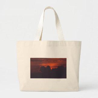 Purple orange sunset clouds large tote bag