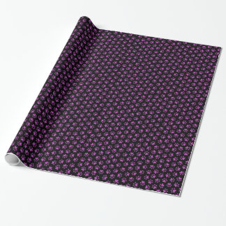 Purple paw print pattern on black background wrapping paper