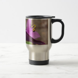 purple plant called spiderwort and a tiny bee travel mug
