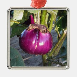 Purple round eggplant hanging on tree metal ornament