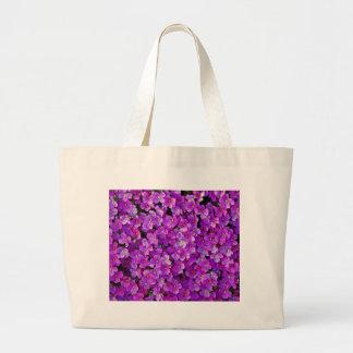 Purple violet flowers background large tote bag
