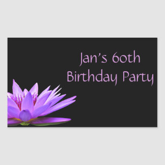Purple water lily on black background sticker