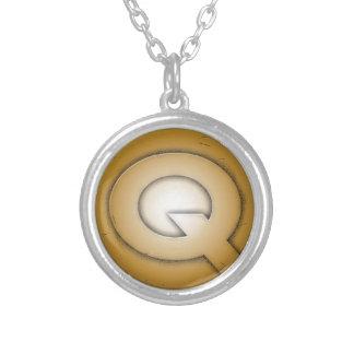 Q initial letter pendants