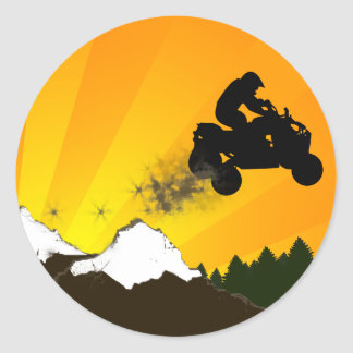quads. orange sunset. classic round sticker