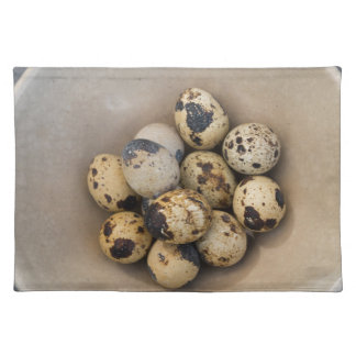 Quails eggs in a bowl placemat