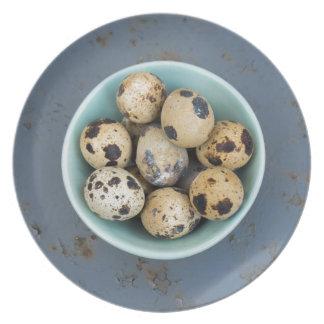 Quails eggs in a green bowl plate