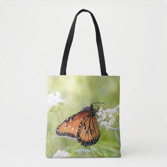 Queen sunning on milkweed tote bag
