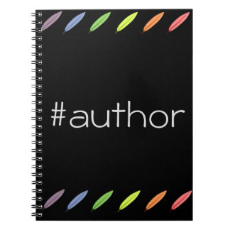 Quill pens and author hashtag notebook