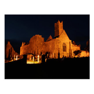 Quin Abbey at night Postcard