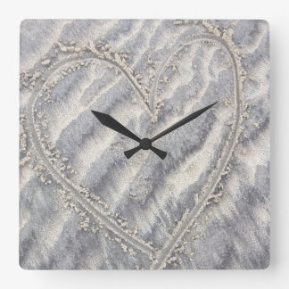 Quirky heart drawing in the sand square square wall clock