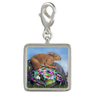 Rabbit on its colorful egg for Easter - 3D render Photo Charm