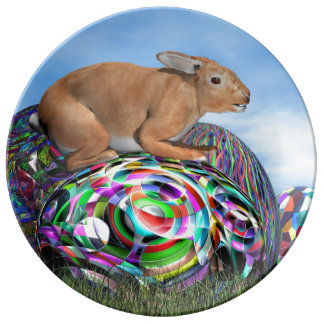 Rabbit on its colorful egg for Easter - 3D render Plate