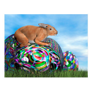 Rabbit on its colorful egg for Easter - 3D render Postcard