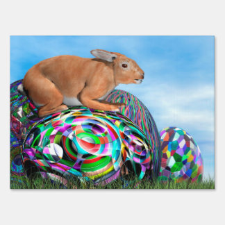 Rabbit on its colorful egg for Easter - 3D render Sign