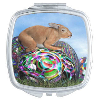 Rabbit on its colorful egg for Easter - 3D render Travel Mirrors