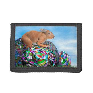 Rabbit on its colorful egg for Easter - 3D render Tri-fold Wallet
