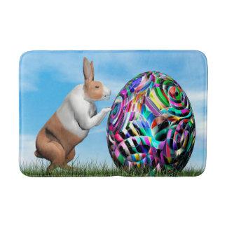Rabbit pushing easter egg - 3D render Bath Mat