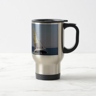 Racing yacht from behind. travel mug