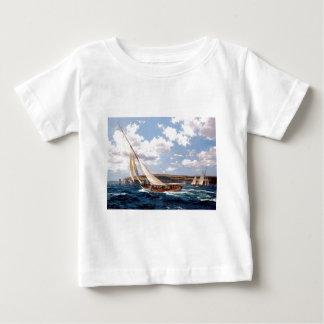 Racing yacht sailing just off the coast baby T-Shirt