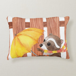 racoon with umbrella walking by fence accent pillow
