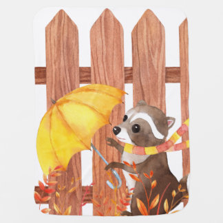 racoon with umbrella walking by fence baby blanket