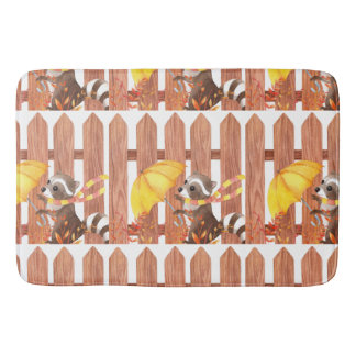 racoon with umbrella walking by fence bath mat
