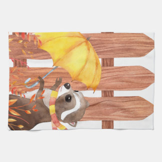 racoon with umbrella walking by fence kitchen towel