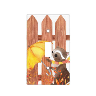 racoon with umbrella walking by fence light switch cover