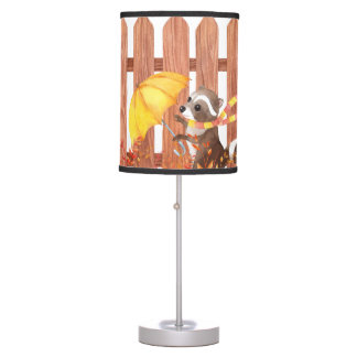 racoon with umbrella walking by fence table lamp