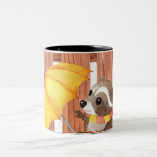 racoon with umbrella walking by fence Two-Tone coffee mug