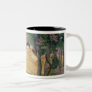 Radha and Krishna embrace in a grove of flowering Two-Tone Coffee Mug