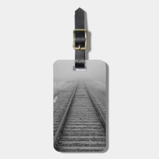 railroad tracks fade into the morning fog luggage tag