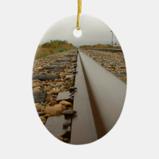 Railroad Tracks on a Rainy Day Ceramic Oval Ornament