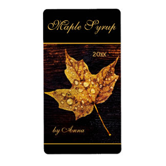 Rain drops on yellow maple leaf shipping label