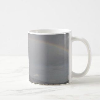 Rainbow on the hills coffee mug