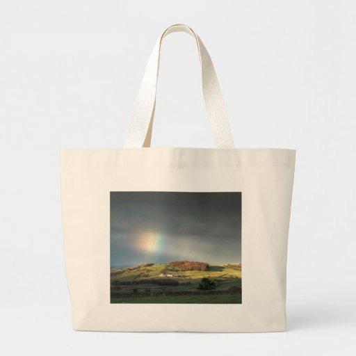 Rainbow over a Lancashire hillside Canvas Bags