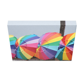 RAINBOW UMBRELLAS ON OCEANFRONT CANVAS PRINT