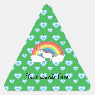 Rainbow unicorn with blue hearts on green triangle sticker