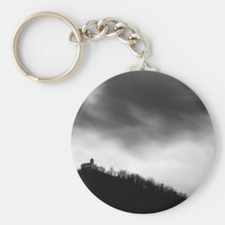 Rainclouds over church keychain