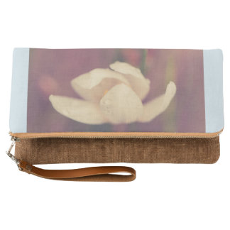 Raindrops on a white flower clutch