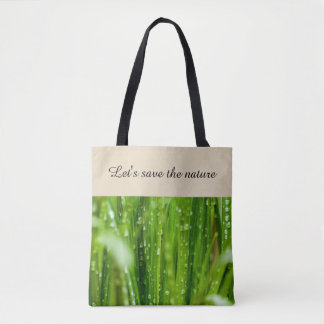 Raindrops on blades of grass tote bag