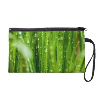 Raindrops on blades of grass wristlet purses