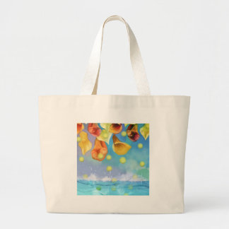 Raining tennis balls over the sea. large tote bag