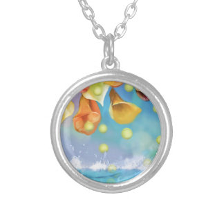 Raining tennis balls over the sea. silver plated necklace