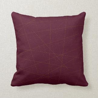 Random golden sticks on garnet burgundy throw pillow