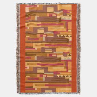 Random patterned warm toned pattern throw