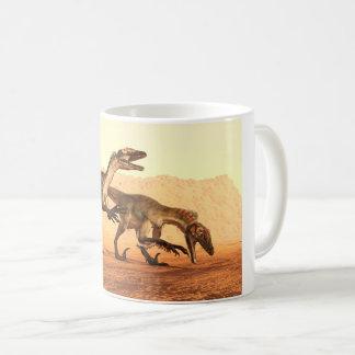 Raptor Dinosaurs in the Desert Coffee Mug