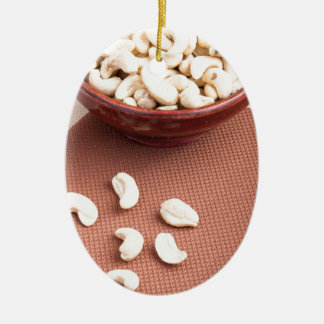Raw cashew nuts for vegetarian food ceramic oval ornament