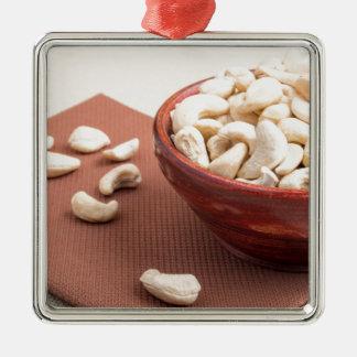 Raw cashew nuts for vegetarian food closeup Silver-Colored square ornament