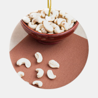 Raw cashew nuts for vegetarian food round ceramic ornament